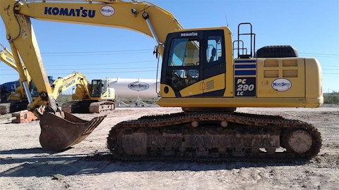 Side of Used Crawler Excavator ready for Sale in yard
