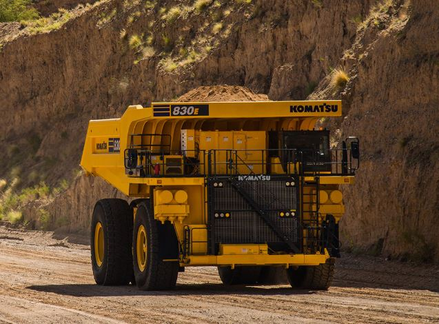 New Komatsu Dump Truck driving with dirt