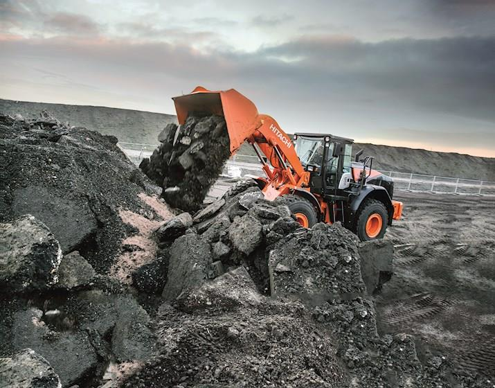 New Hitachi Loader dumping dirt and rock