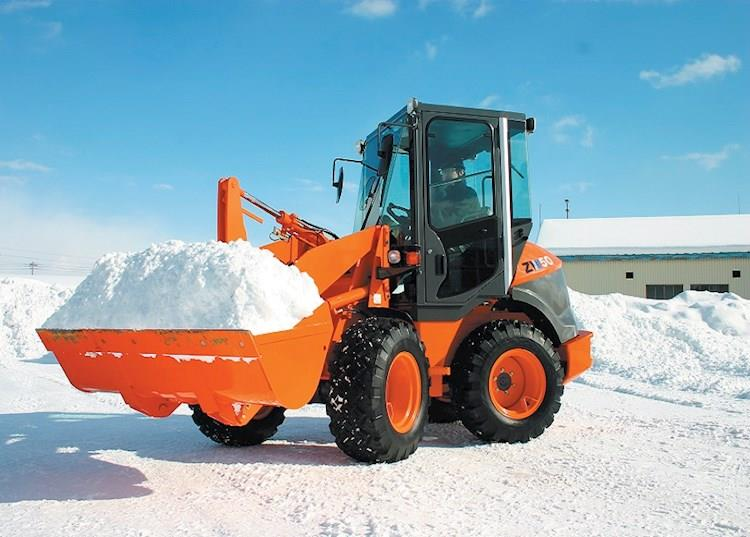 New Hitachi Loader lifting snow