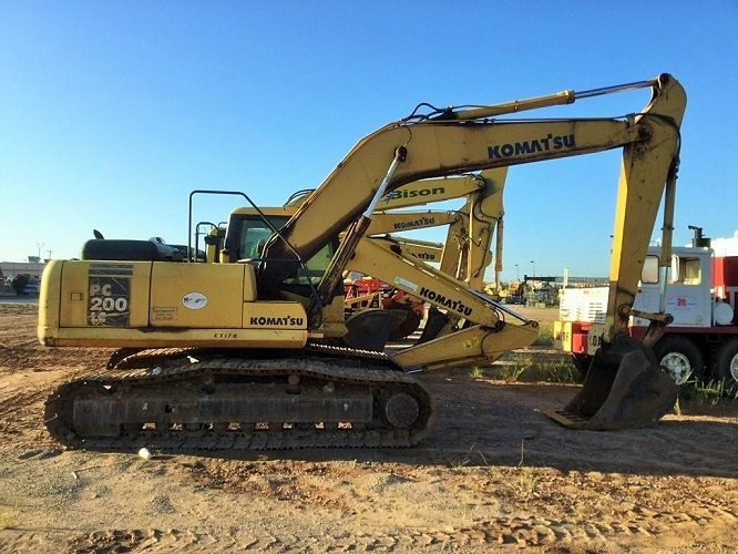 Side of Used Komatsu Excavator for Sale under blue sky