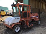 Side of Used Broce Sweeper in Yard for Sale