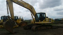 Side of Used Komatsu Excavator for Sale under cloudy sky