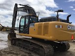 Used Excavator under blue sky for Sale