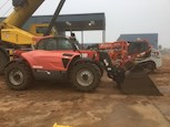 Side of Used Manitou Telehandler for Sale