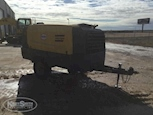 Used Air Compressor under cloudy sky for Sale