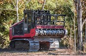 New Fecon Mulching Tractor in woods